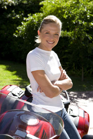 lavishly: Woman posing with motorcycle