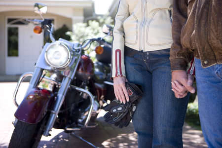 lavishly: Mature couple in motorcycle gear holding hands