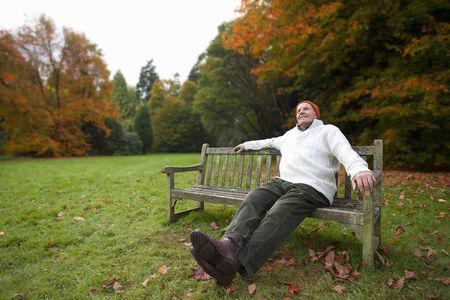 tetbury: Man sitting on bench in park