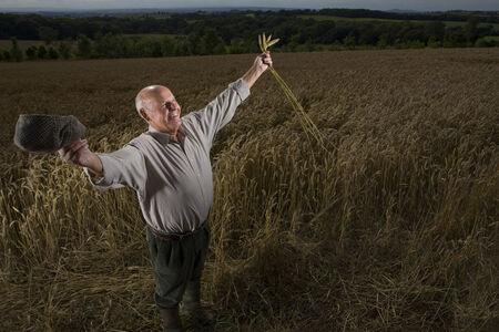 gentleman's: Farmer standing in wheat field