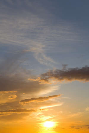 verticals: Sun setting in sky with clouds LANG_EVOIMAGES