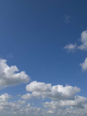 verticals: Clouds in blue sky