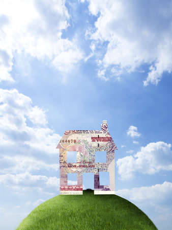 milepost: House made of British pounds on hilltop