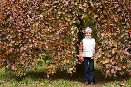 tetbury: Portrait of girl standing against tree