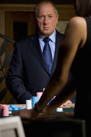 high stakes: Mature man gambling, portrait