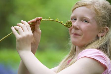 fema: Girl holding fiddlehead fern