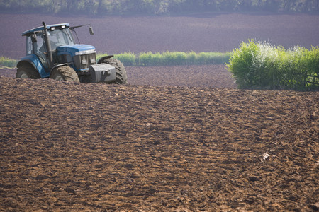 Tractor ploughing field Stock Photo