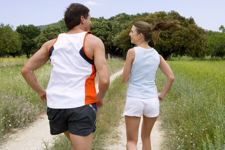 rea: Couple running on rural path LANG_EVOIMAGES