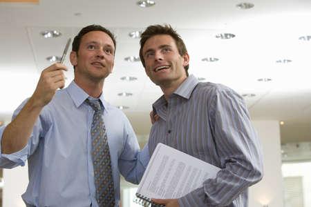Businessmen talking together in office Imagens