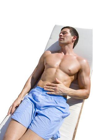 str: Tranquil man laying on lounge chair sunbathing