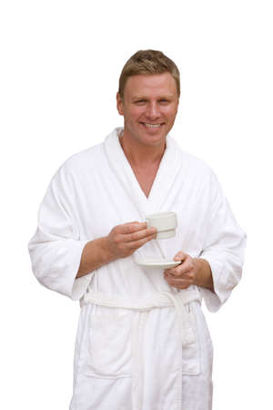 stu: Smiling man in bathrobe drinking coffee