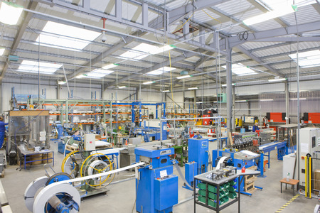 View of machinery in factory which manufactures aluminium light fittings Imagens