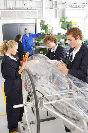Students constructing electric vehicle prototype in vocational school Stock Photo