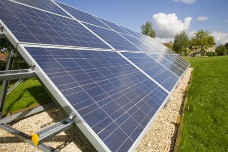 carbon neutral: Large solar panels underneath blue sky LANG_EVOIMAGES