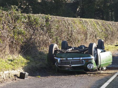 Upside-down car along country lane LANG_EVOIMAGES