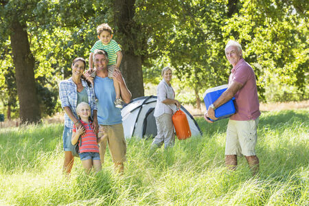 ice chest: Multi-Generation Family Enjoying Camping In Countryside