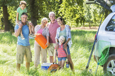 Multi-Generation Family Unpacking Car On Camping Trip Stock Photo - 28618505