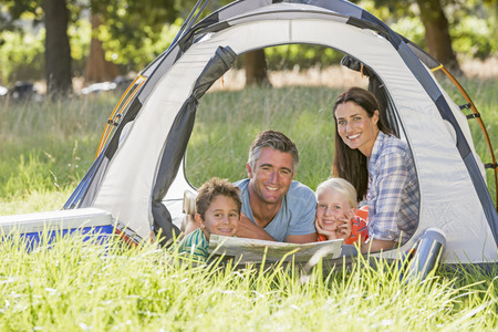 Family Enjoying Camping Holiday In Countryside Stock Photo - 28618364
