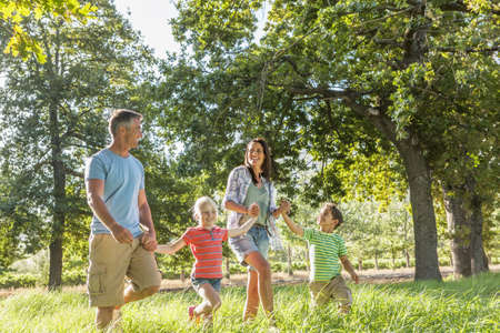 Family Enjoying Walk In Beautiful Countryside Stock Photo - 28577563