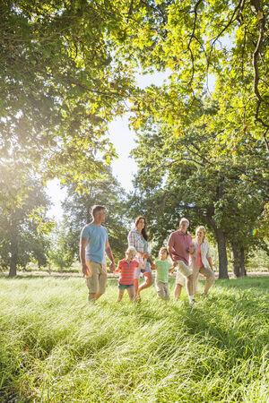 Multi-Generation Family Enjoying Walk In Beautiful Countryside Stock Photo - 28577564