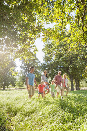 Multi-Generation Family Enjoying Walk In Beautiful Countryside Stock Photo - 28577564