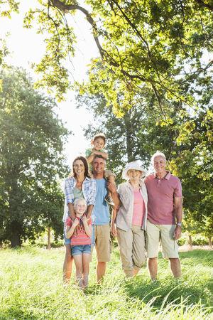 Multi-Generation Family Enjoying Walk In Beautiful Countryside Stock Photo - 28577566