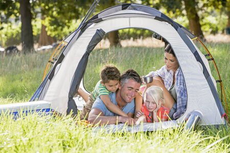 Family Enjoying Camping Holiday In Countryside Stock Photo - 28618365