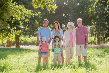Multi-Generation Family Enjoying Walk In Beautiful Countryside Stock Photo - 28618516