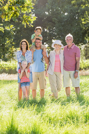 Multi-Generation Family Enjoying Walk In Beautiful Countryside Stock Photo - 28618370