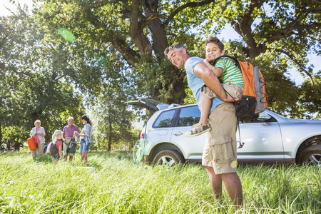 Multi-Generation Family Unpacking Car On Camping Trip Stock Photo - 28618373