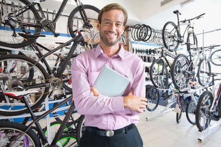 Store owner stood in bicycle shop