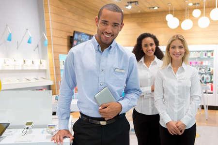 Sales team stood in phone store