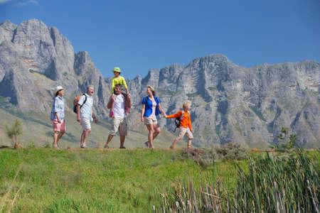 multi generation: Multi generation family hiking on mountain path