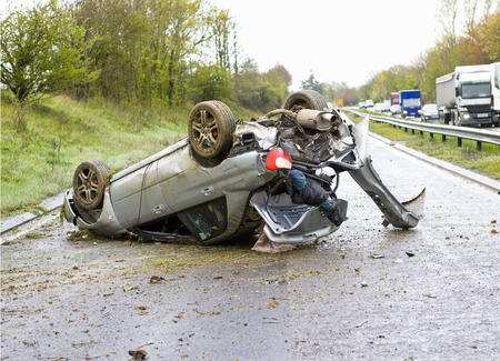 buckled: Upside down crashed car on motorway