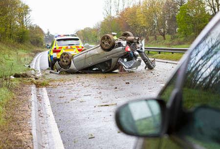 hard drive crash: Upside down crashed car on motorway
