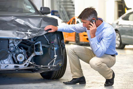 shop skill: Insurance assessor inspecting damaged vehicle