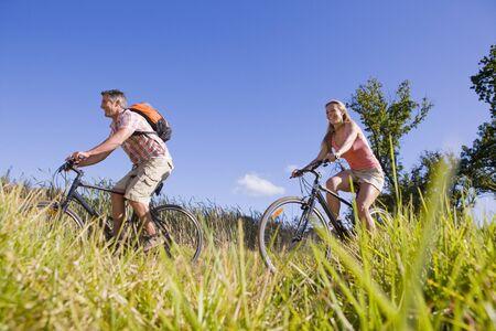mountain biking: Couple mountain biking in countryside