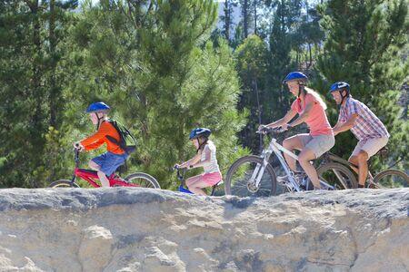 mountain biking: Family, mountain biking, on mountain path
