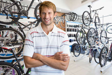 Store manager stood in bicycle shop