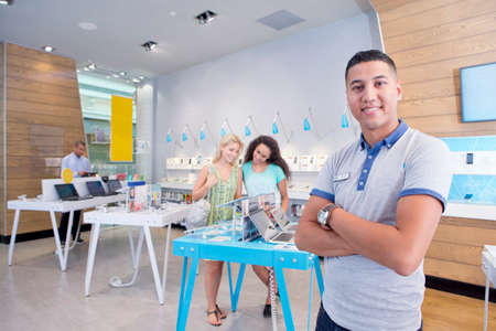 telecommunications: Store assistant and manager in phone shops with customers