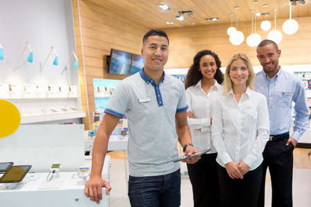 assistant: Sales team stood in phone store