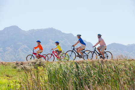 Family riding mountain bikes in the countryside