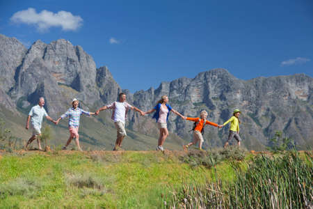 liberated: Multi generation family hiking on mountain path
