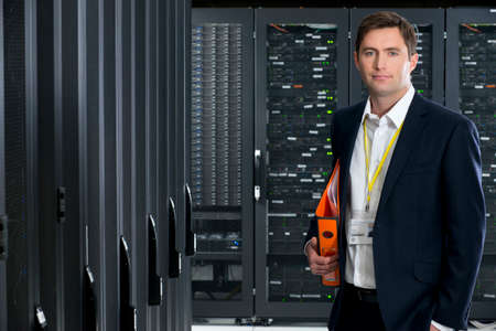 server farm: Manager, looking at camera, in server room