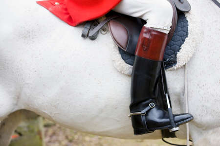 reigns: Boot of hunter on horseback