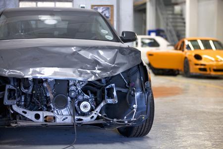 pileup: Damaged car in garage
