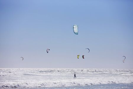 watersports: Kite surfers at sea