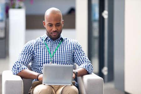 Portrait of man working on digital tablet in office