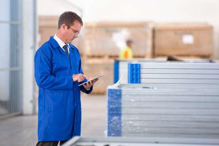 Supervisor worker stock checking solar panels in factory warehouse Stock Photo