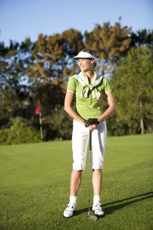 woman golf: Woman standing on a golf course